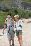 Hikers enjoying their trip on rocky island stock photos