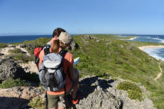 Hikers enjoying trip in carribean islands. Couple of hikers looking at map and scenery royalty free stock photos