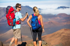 Hikers enjoying the view from the mountain top Stock Photo