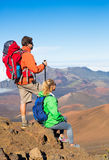 Hikers enjoying the view from the mountain top Royalty Free Stock Image