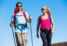 Hikers enjoying walk on amazing mountain trail Royalty Free Stock Images