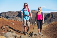 Hikers enjoying walk on amazing mountain trail Royalty Free Stock Image