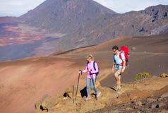 Hikers enjoying walk on amazing mountain trail Royalty Free Stock Images