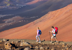 Hikers enjoying walk on amazing mountain trail Stock Photo