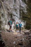 Hikers family in a cave Stock Photography