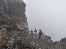 Hikers at Mount Meru, Arusha National Park, Tanzania stock photos