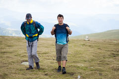 Hikers friends Stock Images
