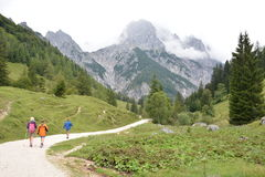 Hikers in front of Ramsauer Dolomiten Royalty Free Stock Photo