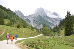 Hikers in front of Ramsauer Dolomiten Royalty Free Stock Photography