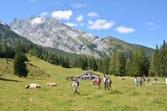 Hikers in front of Watzmann mountain Stock Photo