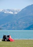 Hikers gear at rest on Harrison lake Stock Photography