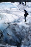 Hikers on Glacier. Hikers and crevasse on Fox Gladier, Westland NP, New Zealand Royalty Free Stock Image