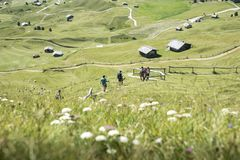 Hikers go down a path. Dolomites, Alps, Italy royalty free stock images