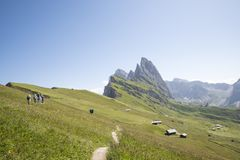 Hikers go down a path. Dolomites, Alps, Italy royalty free stock photography