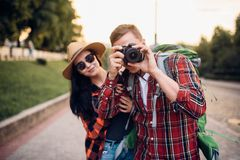 Hikers go sightseeing and makes photo for memory. Hikers with backpacks go sightseeing in tourist town and makes photo for memory. Summer hiking. Hike adventure stock images
