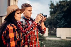 Hikers go sightseeing and makes photo for memory. Hikers with backpacks go sightseeing in tourist town and makes photo for memory. Summer hiking. Hike adventure royalty free stock photo