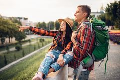 Hikers go sightseeing in tourist town on vacation. Hikers with backpacks go sightseeing in tourist town on vacation. Summer hiking. Hike adventure of young men royalty free stock photography