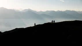 Hikers going up a mountain Stock Photo