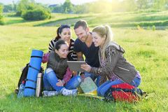 Hikers on the grass Royalty Free Stock Photography