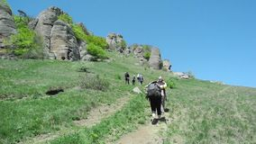 Hikers group trekking in Crimea stock video footage