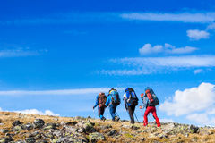 Hikers group trekking in the mountains Stock Photos