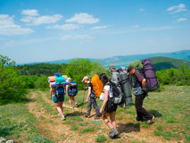 Hikers group walking Royalty Free Stock Photos