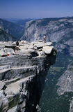 Hikers on Half Dome, Yosemite Park. Hikers on top of Half Dome with view of Yosemite Valley, Yosemite National Park, California Stock Photos