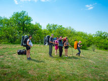Hikers have a rest. On a hillside Royalty Free Stock Image