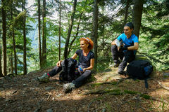 Hikers having a break and a snack Stock Images