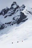 Hikers Heading For Distant Peak In Snow Royalty Free Stock Photography
