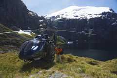 Hikers With Helicopter On Mountain Top Stock Photos