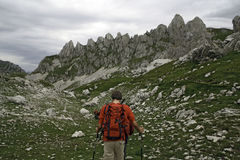 Hikers at high mountains Stock Images