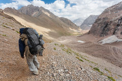 Hikers in high mountains. Stock Photos