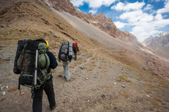 Hikers in high mountains. Stock Images