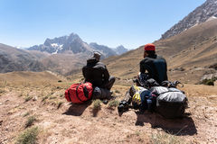Hikers in high mountains. Royalty Free Stock Image
