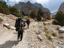 Hikers in high mountains. Royalty Free Stock Photography