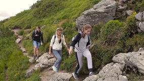 Hikers hiking in beautiful landscape. Man and women trekking walking with backpacks in mountains stock footage