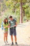 Hikers - hiking couple looking at map Stock Photo