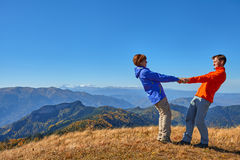 Hikers hiking enjoying view looking at mountain landscape Stock Photos