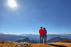 Hikers hiking enjoying view looking at mountain landscape Royalty Free Stock Image