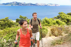 Hikers hiking in Mallorca mediterranean Europe. Hikers hiking in Mallorca, mediterranean Europe. Young adults couple walking in beautiful nature landscape on the Royalty Free Stock Photos