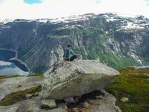 Trolltunga, Odda, Norway 21. June 2016, Hikers on the hiking trail to the world famous Trolltunga hike. Beautiful Norway, outdoors royalty free stock photo