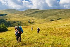 Hikers on a hill slope Royalty Free Stock Photography