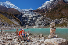 Hikers in Himalayas royalty free stock image