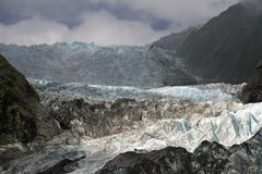 Hikers on ice falls on Franz Joseph Glacier Royalty Free Stock Images