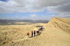 Hikers In Negev Desert. Stock Photo