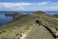Hikers on Inca Trail on Isla del Sol with Titicaca. Hikers on Isla del Sol's Inca Trail to the tip of the island, Chinkana, Labyrinth (Laberinto) and Saint Rock Royalty Free Stock Photos