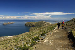 Hikers on Inca Trail on Isla del Sol with Titicaca Stock Photo