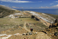 Hikers on Inca Trail on Isla del Sol with Titicaca Stock Photos