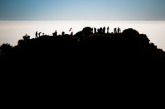 Hikers in Java province. Photo of hikers at top of mountain near Mount Merbabu in Yogya in central Java province in Indonesia. In this region, one can only meet Royalty Free Stock Photos